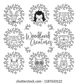 Cute hand drawn vector animals in wreath.