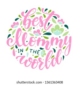 Cute hand lettering quote 'Best mommy in the world' for the Mother's day. Print, poster, sticker, banner, card design decorated by floral elements pn white background. festive background template.