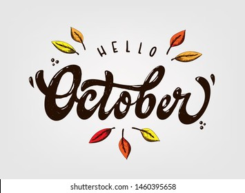 cute hand lettering quote 'Hello October' decorated with sketched autumn leaves. Good for posters, baners, cards, invitations, etc. Typography inscription. EPS 10
