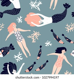 Cute hand-drawn seamless pattern with mermaids, swimming girls and corals. Magic endless design for fabric, wrap paper or wallpaper.