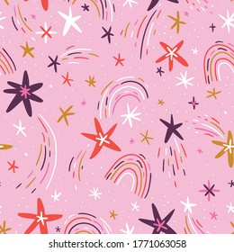 Cute hand-drawn seamless pattern with stars and rainbows on pink background. Vector repeated design for kids fabric.