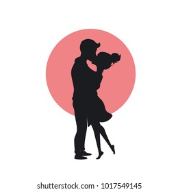 cute happy couple in love hugging and kissing romantic silhouette