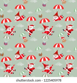 Cute happy Santa Claus falling with a parachute