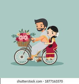 cute Indian couple with bicycle with flower in traditional dress