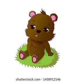 Cute little bear is sitting on the grass