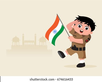 Cute Little boy dressed like an Indian Army Soldier saluting and holding National Flag on Red Fort background for Independence Day.