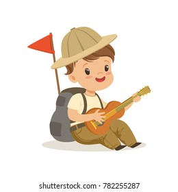 Cute little boy in scout costume playing guitar, outdoor camp activity vector Illustration