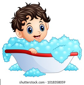 Cute little boy taking a bath on a white background
