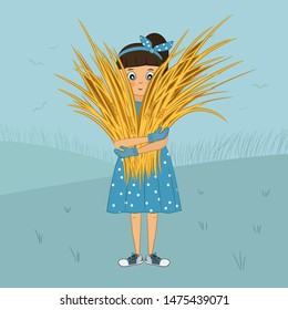Cute little girl in blue polka dot dress and sneakers holds sheaf of wheat. Child from countryside