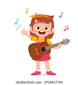 cute little girl play guitar in concert