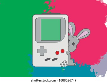 A cute little gray rabbit peeks out from behind an old game console. The Gameboy is from the past and was very popular. the rabbit hugs the console and holds it tight with his paws.