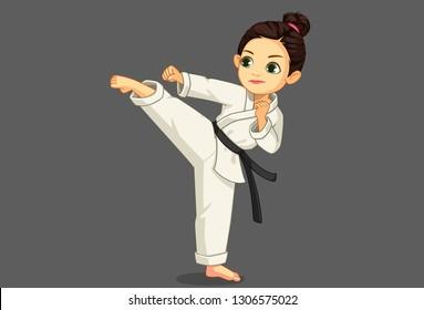 Cute little karate girl in karate pose 2