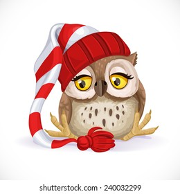 Cute owlet in a cap sits and wants to sleep