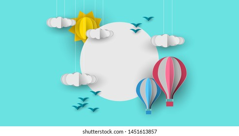 Cute papercut sky landscape background with white copy space circle frame. Hot air balloon, sun and clouds made in realistic paper craft art or origami style for baby nursery, children design.