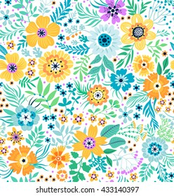 Cute pattern in small flower. Small colorful flowers. White background. Folk floral background. The elegant the template for fashion prints.