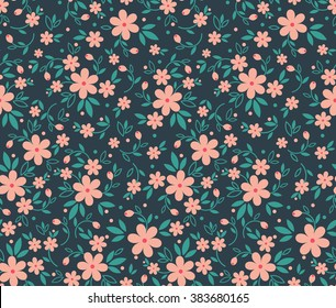 Cute pattern in small flower. Small pink flowers. Blue background.