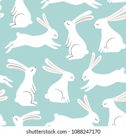 Cute rabbit vector pattern. Hand drawn white bunnies on blue background. Spring easter seamless print.
