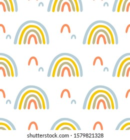 Cute rainbows in cartoon style seamless vector pattern. Delicate pastel shades, simple shapes.