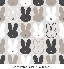 Cute Scandinavian Easter Bunny seamless pattern with primitive geometric silhouettes of rabbit head in neutral colors for your decoration