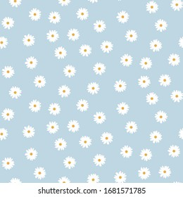 Cute seamless pattern with floral motif on a pastel blue background. White camomiles. Spring and summer. Vintage. Wallpaper, dresses, packaging, tea.