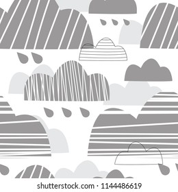 Cute seamless pattern with gray clouds. Gray clouds and raindrops. Rainy sky. Vector illustration of a Scandinavian children's style. Suitable for printing on fabric, bedding, clothing, paper, wallpap