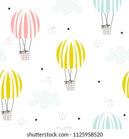 Cute seamless pattern with pastel hot air balloons and clouds. Vector hand drawn illustration.
