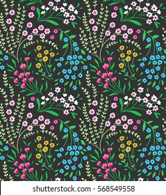Cute seamless pattern in small flower. Small pink, yellow and blue flowers. Dark green background. Ditsy floral style. The elegant the template for fashion prints.