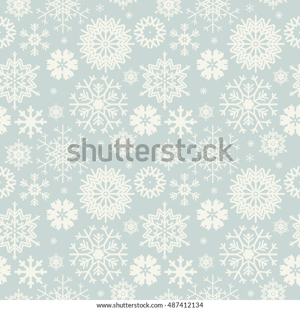 Cute seamless pattern with snowflakes isolated on light blue background.  Winter image for your designs.