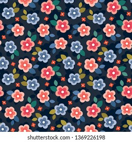 Cute seamless vector floral mini print in coral, blush pink, blue and red on dark navy background. Colorful summer pattern design for gift wrapping paper, textiles, homewares and fashion.