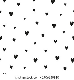 Cute simple black and white seamless pattern with hearts. Great for Valentine's day, clothing, textile, wrapping paper, scrapbooking, etc.