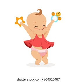 Cute smiling baby girl playing with rattles, colorful cartoon character vector Illustration