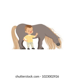 Cute smiling little boy standing next pony horse, kid taking care of his animal vector Illustration