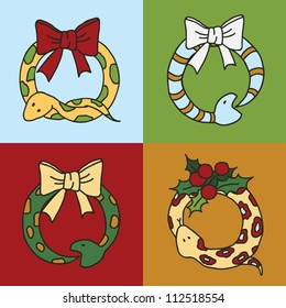 Cute snake wreaths for the New year of the snake with bows and mistletoe
