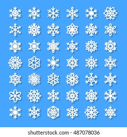 Cute snowflake collection isolated on blue background. Flat icons, snow flakes silhouette. Nice element for christmas, new year banner, cards. Organic and geometric ice set.
