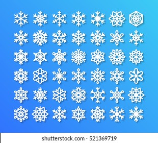 Cute snowflake collection isolated on blue background. Flat icons of snow flakes silhouette.