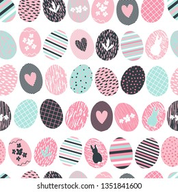 Cute and sweet seamless repeated pattern background with decorated and textured easter eggs in rows