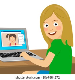 Cute teenager girl chatting with her girlfriend using laptop at office looking over shoulder