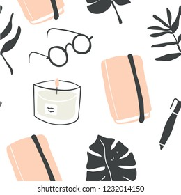 Cute vector seamless pattern of autumn and winter hygge blogger elements - candle, notebook, monstera leaf, glasses, book. Isolated on white background. Scandinavian style.