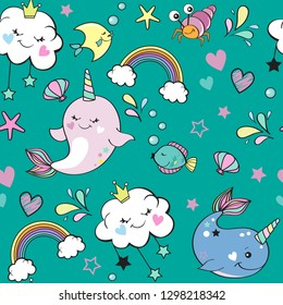 Cute whale unicorn, rainbow and marine inhabitants on a blue background seamless pattern