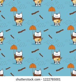 Cute white little kitty wearing a stripe scarf and scott pattern pants,hold a dot umbrella under raindrops on nice blue background.Cartoon animal vector illustration.Seamless pattern for kids fasion.