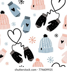 Cute winter vector seamless pattern with hats, mittens, snowflakes and hearts. Merry xmas, new year pattern. Winter Cartoon christmas icons and elements
