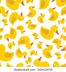 Cute yellow rubber duck with eye, orange beak, tale, wing, without paws, topknot, crest. Vector seamless pattern. Customized fun background. For cards, baby shower, paper, fabric, wallpaper.