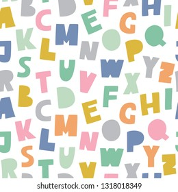 Cutout ABC seamless pattern. Cute alphabet. Playful font print for textile, home decor, kids room wall art. Soft pastel colors – pink, blue, yellow.