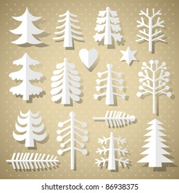 Cutting Christmas trees of white paper