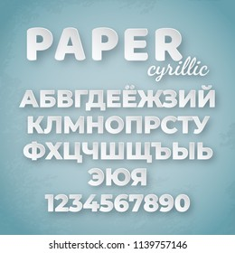 Cyrillic paper alphabet. White letters and numbers on blue background. Creative funny font for design template