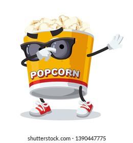 Dabbing cartoon filled yellow popcorn bucket mascot on white background