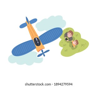 Dad and his Son Launching Airplane Model, Parent and Son Spending Time Together Outdoors Cartoon Style Vector Illustration