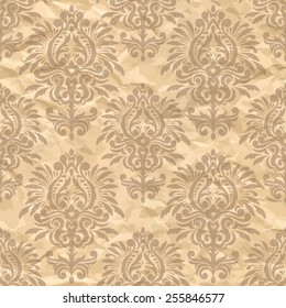 Damask seamless pattern on the crumpled paper. Vintage wallpaper pattern