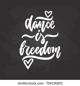 Dance is freedom - lettering dancing calligraphy quote drawn by ink in white color on the black chalkboard background. Fun hand drawn lettering inscription