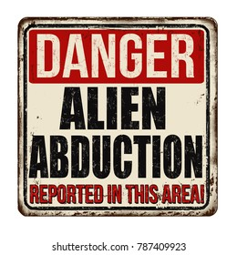 Danger alien abduction vintage rusty metal sign on a white background, vector illustration